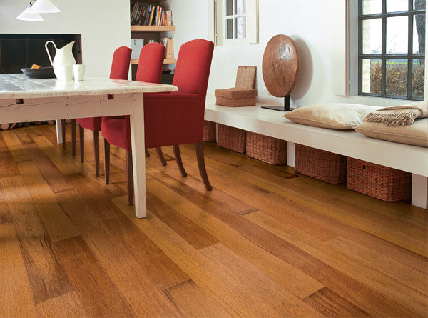 What is the difference between hardwood flooring and laminate flooring