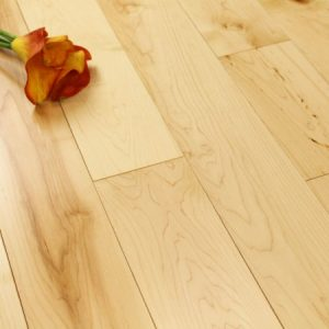 Pale yellow Maple flooring with a single flower on top