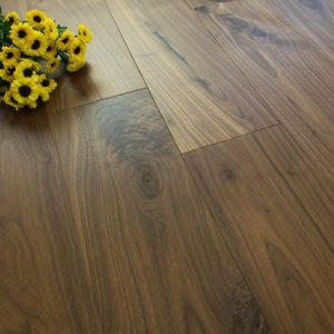 dark brown walnut flooring with flowers on top